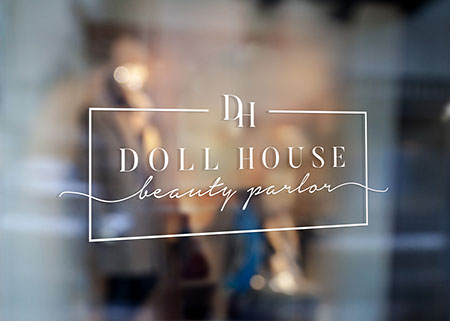Doll House logo on glass signage